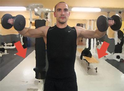 Hantellyft åt sidan - Sänk vikterna i en lugn kontrollerad rörelse.